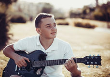 Teenager Learning To Play Stock Images