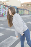 Teenager leenager look before crossing the street Royalty Free Stock Photos