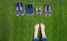 Teenager legs and shoes standing  on grass Stock Photo