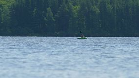Teenager in lifejacket in kayak. Sunny day on wonderful lake. 15th of July 2019, Lipno lake, Czech Republic. Summer time stock video