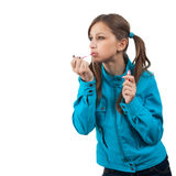 Teenager with lipstick over white. Young woman in blue jacket with lipstick isolated over white stock photo