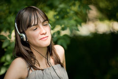 Teenager listening music Royalty Free Stock Photo