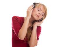 Teenager listening music Royalty Free Stock Image
