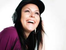 teenager listening music in headphones Stock Photo