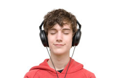 Teenager listening music with headphones. Isolated on pure white Stock Image