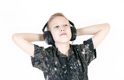 Teenager listening music with headphones, isolated on pure white. Stock Photos