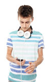 Teenager listening music on headphones Royalty Free Stock Image
