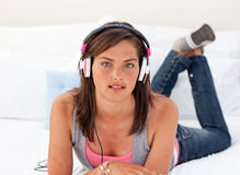 Teenager listening to the music on his bed Stock Photos