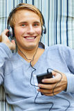 Teenager listening to music Royalty Free Stock Photo