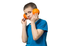 Teenager listening to music via headphones fruit. Boy in a good mood Royalty Free Stock Photography