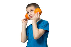 Teenager listening to music via headphones fruit. Boy in a good mood Royalty Free Stock Image