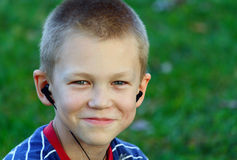 Teenager listens to music Royalty Free Stock Image