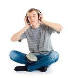 The teenager listens to music Stock Images