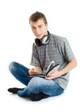 The teenager listens to music Royalty Free Stock Photos