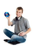 The teenager listens to music. In ear-phones Stock Photos