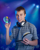The teenager listens to music Royalty Free Stock Images