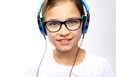 The teenager listens to music. Royalty Free Stock Photos