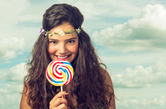 Teenager with Lollipop. Pretty brunette teenager eager for her big and sweet lollipop Stock Photography