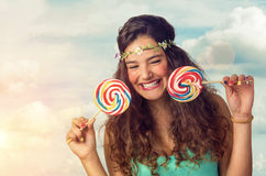 Teenager with Lollipop. Pretty brunette teenager eager for her big and sweet lollipop Royalty Free Stock Images