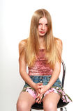 Teenager with long hair. Portrait of attractive teenager with long blond hair; white studio background Royalty Free Stock Photography