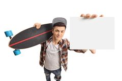 Teenager with a longboard showing a blank card. Isolated on white background royalty free stock images