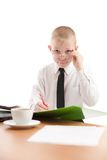 Teenager look over glasses in usual office space Royalty Free Stock Photography