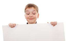 Teenager standing by white blank card. Teenager looking down on a white board stock images