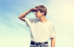 Teenager looking for Someone. Toned Photo of Teenager looking for Someone outdoor Royalty Free Stock Images
