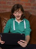 Teenager looking at tablet computer Stock Photos