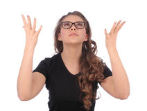 Teenager looking up with open hands up. On white background Royalty Free Stock Image