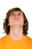 Teenager looks upward. On white background Stock Photos