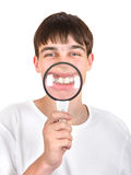Teenager with a Loupe Royalty Free Stock Image