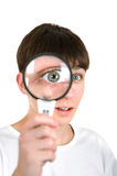 Teenager with a Loupe Royalty Free Stock Photo