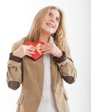 Teenager in love. Young teenage girl posing a heart-shaped box in her heart Royalty Free Stock Photos