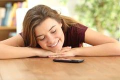 Teenager loving her smart phone Stock Image