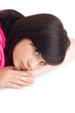 Teenager lying on floor Stock Photography