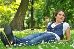 Teenager lying in grass Stock Photography
