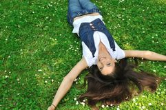 Teenager lying in grass Royalty Free Stock Photos