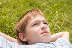 Teenager lying on  grass. Royalty Free Stock Photos
