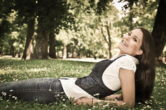 Teenager lying in grass Stock Photos