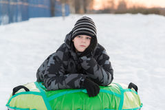 Teenager lying on green tubing Stock Photos