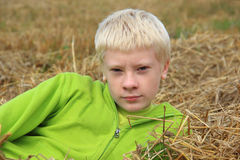 Teenager lying in the straw Royalty Free Stock Images