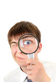 Teenager with Magnifying Glass Royalty Free Stock Photography