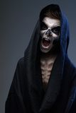 Teenager with makeup skull cape Royalty Free Stock Images