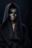 Teenager with makeup skull cape Stock Images