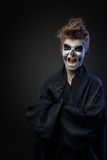 Teenager with makeup skull cape Royalty Free Stock Photography