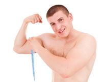 Teenager man presents his muscles Royalty Free Stock Photography