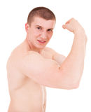 Teenager man presents his muscles Royalty Free Stock Photo