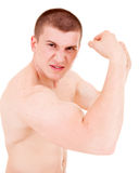 Teenager man presents his muscles Royalty Free Stock Image