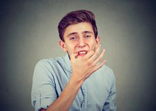 Teenager man trying to whistle isolated on gray wall background. Teenager man trying to whistle Royalty Free Stock Photography